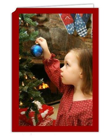 Grusskarte zu Weihnachten gestaltet mit Foto eines Mädchens am Weihnachtsbaum